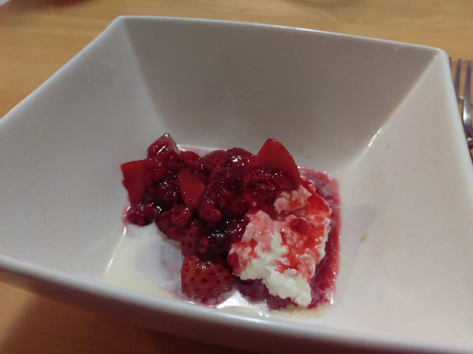 curds with raspberries in honey